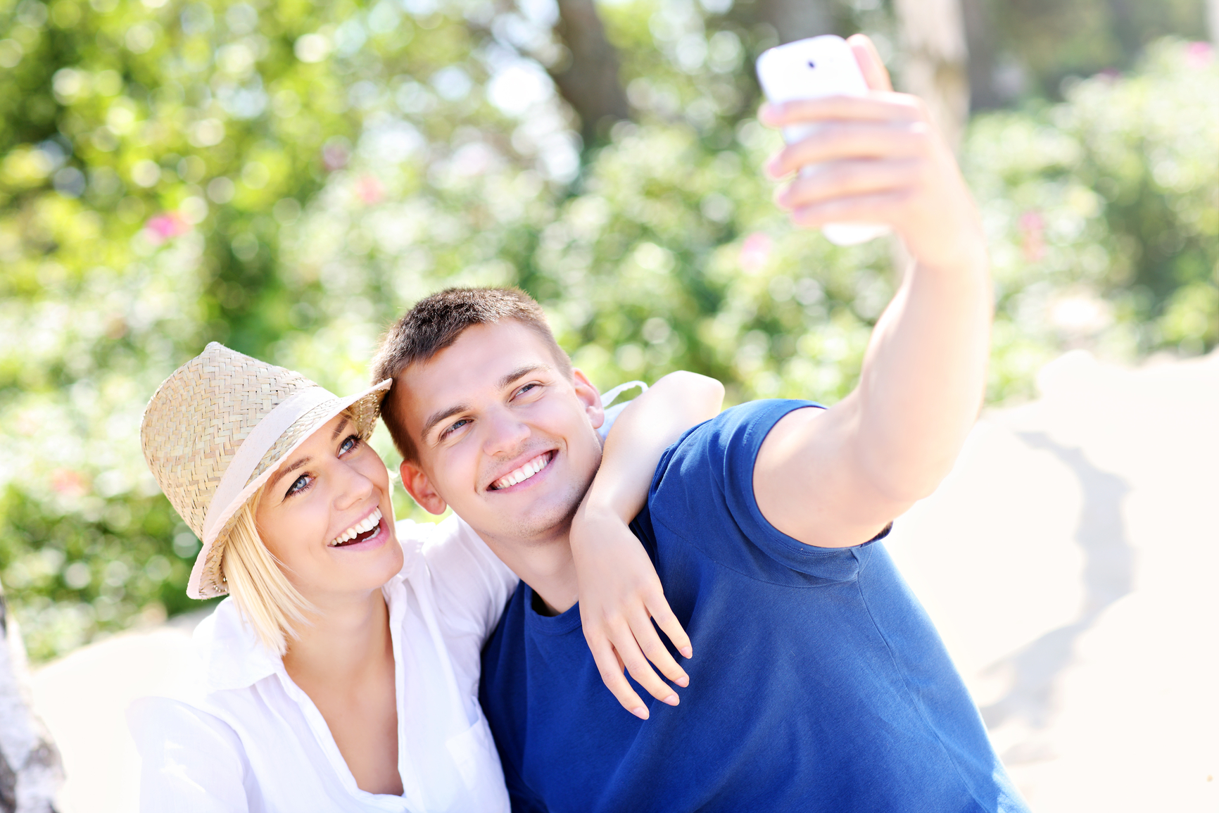 Young couple taking a picture of themselves smiling